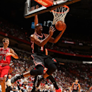Chris Bosh #1 of the Miami Heat goes up for the reverse layup against the Chicago Bulls at the American Airlines Arena in Miami, Florida on Feb. 3, 2014. (Photo by Issac Baldizon/NBAE via Getty Images)