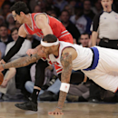 New York Knicks forward Kenyon Martin (3) dives for the ball as Chicago Bulls guard Kirk Hinrich (12) dribbles in the first half of their NBA basketball game at Madison Square Garden in New York, Wednesday, Dec. 11, 2013 The Associated Press