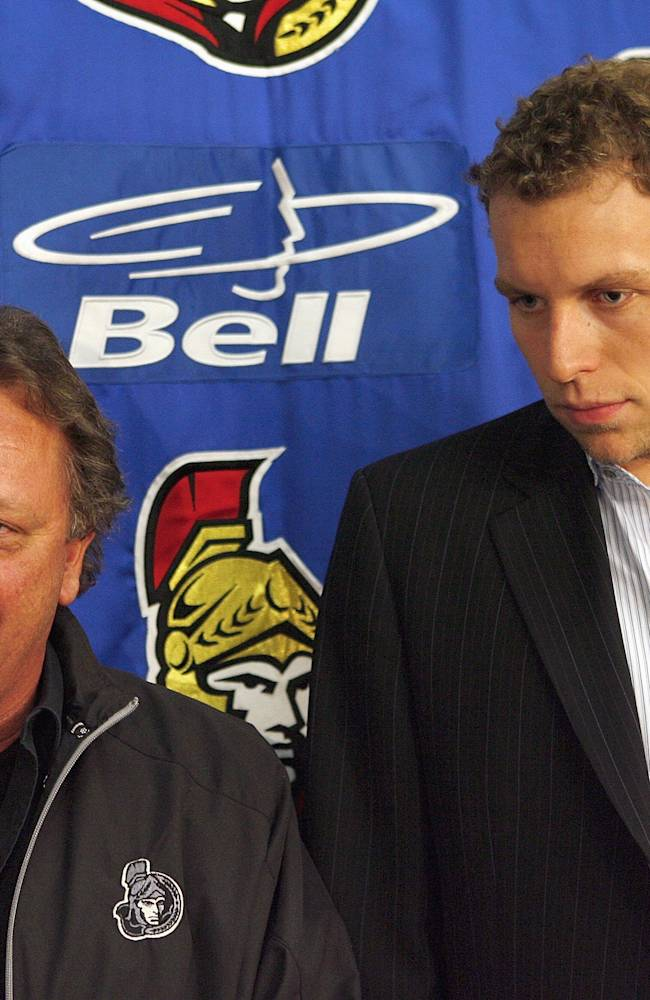FILE - Eugene Melnyk and Dany Heatley #15 of the Ottawa Senators meet with the press for a photo opportunity regarding Dany Heatley's contract extension just before the start of the 2007-2008 NHL season before a game against the Toronto Maple Leafs on October 4, 2007 at the Scotiabank Place in Ottawa, Canada. (Photo by Phillip MacCallum/Getty Images)