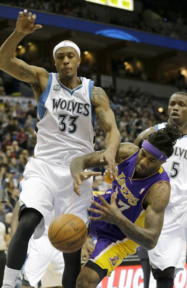 Los Angeles Lakers forward Jordan Hill (27) falls as he battles Minnesota Timberwolves forward Dante Cunningham (33) for a rebound during the second quarter of an NBA basketball game in Minneapolis, Friday, March 28, 2014. Timberwolves center Gorgui Dieng (5) looks on