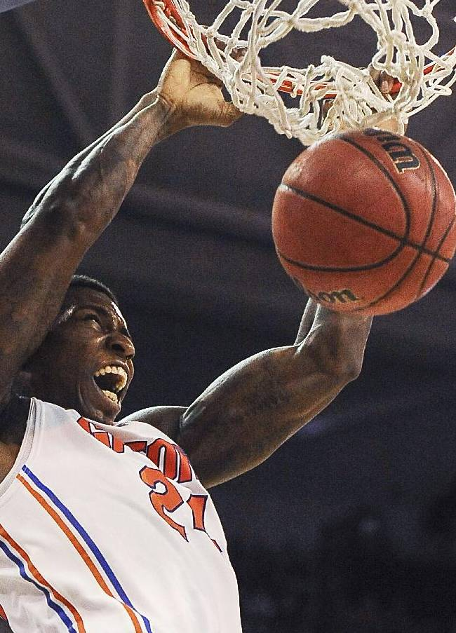 Florida forward Casey Prather (24) dumps the ball through the basket during the first half of an NCAA college basketball game against South Carolina, Wednesday, Jan. 8, 2014 in Gainesville, Fla