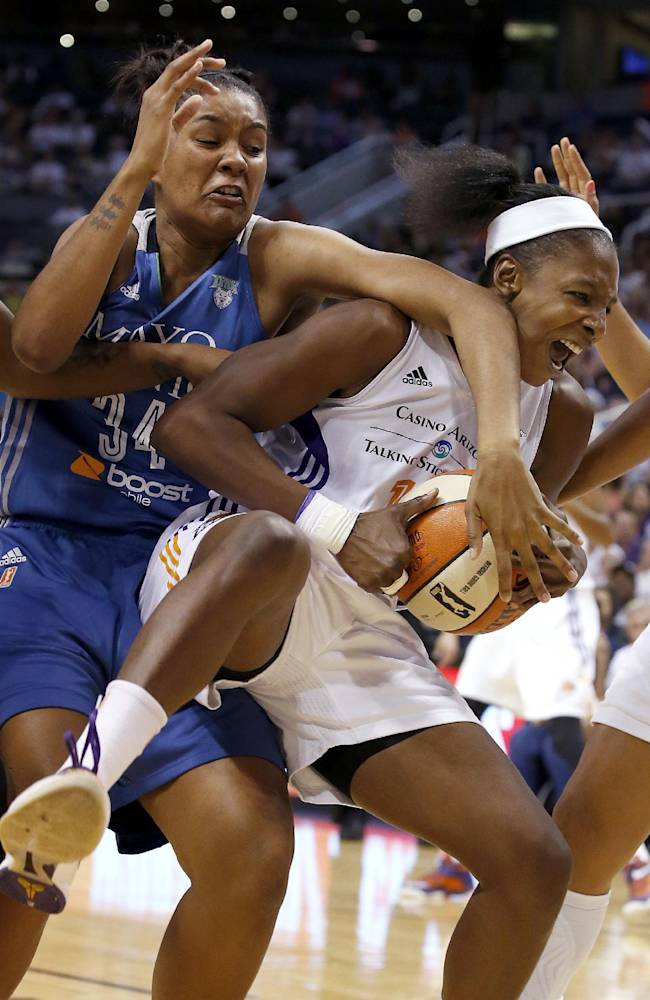 Phoenix Mercury's Eshaya Murphy, right, grabs a rebound in front of Minnesota Lynx's Damiris Dantas (34) during the first half of Game 3 in the WNBA Western Conference basketball finals Tuesday, Sept. 2, 2014, in Phoenix