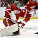 Detroit Red Wings goalie Jonas Gustavsson (50), of Sweden, makes a save during the first period of an NHL hockey game against the Calgary Flames, Thursday, Dec. 19, 2013, in Detroit. (AP Photo/Duane Burleson)
