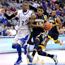 Marquette's Vander Blue, right, drives to the basket against Seton Hall's Fuquan Edwin during the first half of an NCAA college basketball game Tuesday, Feb. 19, 2013, in Newark, N.J. (AP Photo/Bill Kostroun)