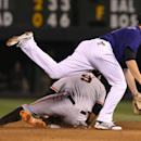 Colorado Rockies second baseman DJ LeMahieu, top, forces out San Francisco Giants' Brandon Belt at second base on the front end of a double play hit into by Brandon Hicks in the fourth inning of a baseball game in Denver on Monday, April 21, 2014 The Asso