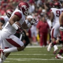 Arkansas White Team safety Tiquention Coleman (7) returns an interception during the first half of a spring NCAA college football game in Fayetteville, Ark., Saturday, April 20, 2013. Arkansas Red beat Arkansas White 34-27. (AP Photo/Gareth Patterson)