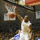 Wichita State's Tekele Cotton dunks the ball in the second half of an NCAA college basketball game against Drake, Sunday, Jan. 25, 2015, in Wichita, Kan. (AP Photo/The Wichita Eagle, Jaime Green)