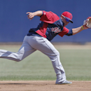 Cleveland Indians shortstop Asdrubal Cabrera goes after a ball behind second during fielding drills prior to a spring training exhibition baseball game against the San Diego Padres Saturday, March 29, 2014, in San Diego The Associated Press