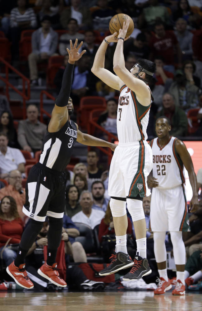 Miami Heat center Justin Hamilton (7) prepares to shoot against Miami Heat guard Dwyane Wade (3) during the first half of an NBA basketball game in Miami, Tuesday, Jan. 27, 2015. (AP Photo/Alan Diaz)