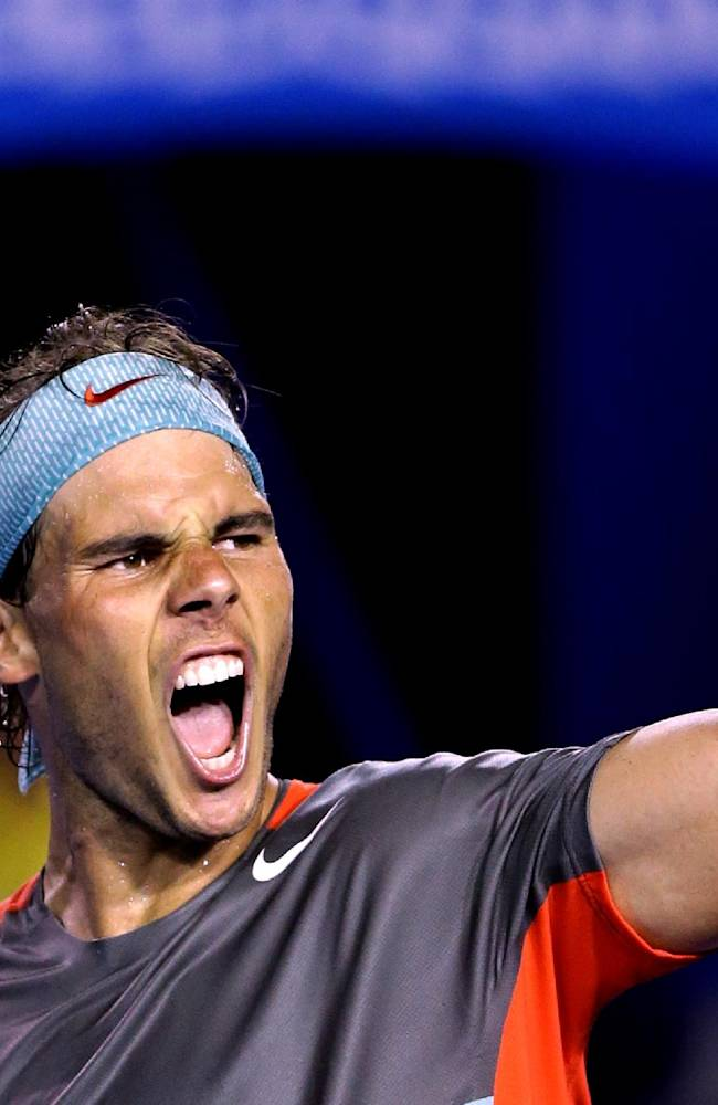 Rafael Nadal of Spain celebrates after defeating Roger Federer of Switzerland during their semifinal at the Australian Open tennis championship in Melbourne, Australia, Friday, Jan. 24, 2014