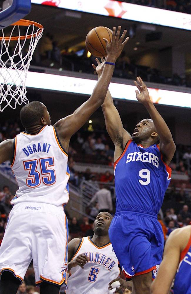 Philadelphia 76ers' James Anderson, right, shoots as Oklahoma City Thunder's Kevin Durant defends during the first half of an NBA basketball game, Saturday, Jan. 25, 2014, in Philadelphia