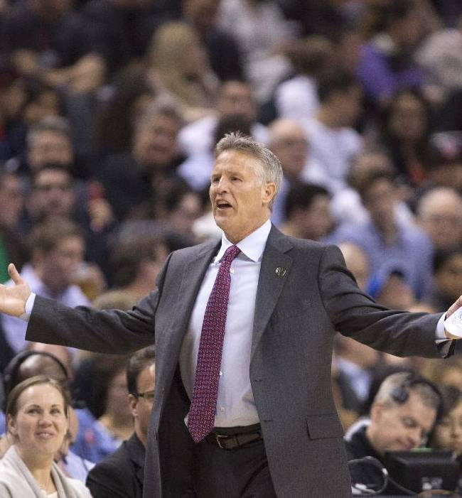 Philadelphia 76ers head coach Brett Brown questions a call during first half NBA action against the Toronto Raptors in Toronto on Wednesday, April 9, 2014
