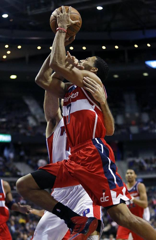 Washington Wizards guard Garrett Temple (17) is fouled by Detroit Pistons forward Luigi Datome while going to the basket during the first half of an NBA basketball game, Monday, Dec. 30, 2013, in Auburn Hills, Mich