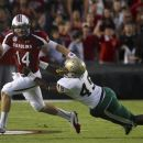 South Carolina quarterback Connor Shaw, left, is forced out of the pocket by UAB linebacker Chris Rabb, right, during the first half of an NCAA college football game at Williams-Brice Stadium in Columbia, S.C., Saturday, Sept. 15, 2012. (AP Photo/Brett Flashnick)