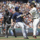 Milwaukee Brewers' Shane Peterson, left, is tagged out by San Francisco Giants shortstop Brandon Crawford on a rundown between home plate and third base on a fielder's choice in the eighth inning of a baseball game, Wednesday, July 29, 2015, in San Francisco. Looking on is third base umpire Tony Randazzo. (AP Photo/Eric Risberg)
