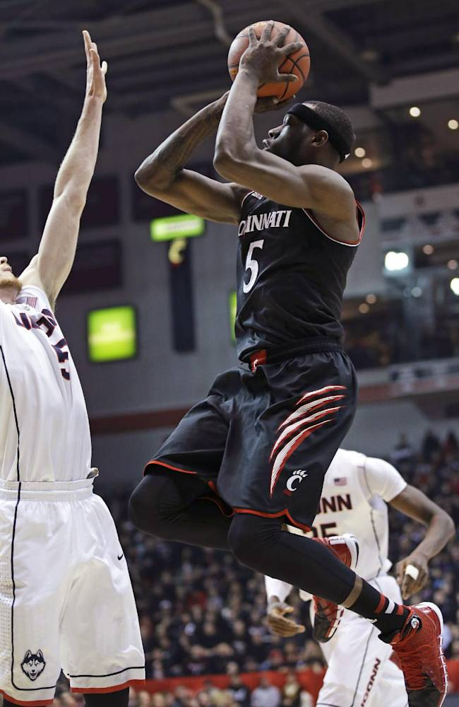 Cincinnati forward Justin Jackson (5) shoots against Connecticut during the first half of an NCAA college basketball game, Thursday, Feb. 6, 2014, in Cincinnati