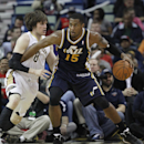 Utah Jazz center Derrick Favors (15) backs into New Orleans Pelicans forward Luke Babbitt (8) in the first half of an NBA basketball game in New Orleans, Friday, March 28, 2014 The Associated Press