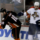 Anaheim Ducks right wing Corey Perry, left, checks Florida Panthers defenseman Erik Gudbranson during the third period of an NHL hockey game in Anaheim, Calif., Sunday, Nov. 16, 2014 The Associated Press