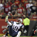New England Patriots wide receiver Brandon LaFell (19) cannot come up with a pass as Kansas City Chiefs free safety Husain Abdullah, bottom, defends during the fourth quarter of an NFL football game Monday, Sept. 29, 2014, in Kansas City, Mo The Associate