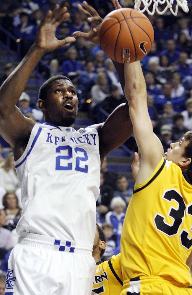 Kentucky's Alex Poythress (22) looses the ball next to Northern Kentucky's Anthony Monaco (33) during the first half of an NCAA college basketball game Sunday, Nov. 10, 2013, in Lexington, Ky