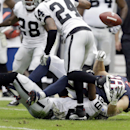 Houston Texans' Garrett Graham (88) fumbles as he is hit by Oakland Raiders' Lamarr Houston during the first half of an NFL football game Sunday, Nov. 17, 2013, in Houston. The Raiders recovered the fumble The Associated Press