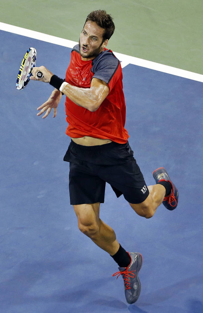 Feliciano Lopez, of Spain, returns a shot to Dominic Thiem, of Austria, during the third round of the U.S. Open tennis tournament Sunday, Aug. 31, 2014, in New York