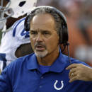 Indianapolis Colts head coach Chuck Pagano works on the sideline in the first half of an NFL preseason football game against the Cincinnati Bengals, Thursday, Aug. 28, 2014, in Cincinnati. (AP Photo/Tom Uhlman)