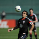 D.C. United midfielder Dwayne De Rosario (7) eyes the ball against the Columbus Crew during the first half of an MLS soccer game, Saturday, March 23, 2013, in Washington. (AP Photo/Nick Wass)