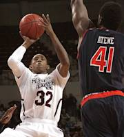 Mississippi State's Craig Sword (32) shoots over Auburn's Matthew Atewe (41) in the first half of an NCAA college basketball game in Starkville, Miss., Wednesday, Jan. 22, 2014. (AP Photo/Jim Lytle)