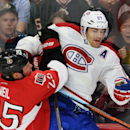 Ottawa Senators' Chris Neil, left, hits Montreal Canadiens' Max Pacioretty into the boards during first period of a preseason NHL hockey game in Ottawa, Ontario, on Friday, Oct. 3, 2014 The Associated Press