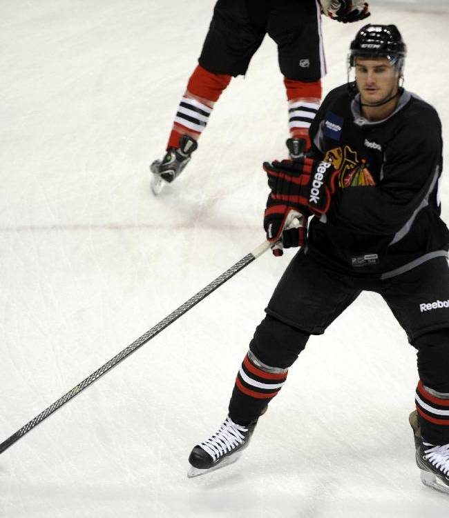 Chicago Blackhawks' Brandon Saad skates backwards during a drill at NHL hockey training camp on the campus of the University of Notre Dame in South Bend, Ind., Thursday, Sept. 12, 2013