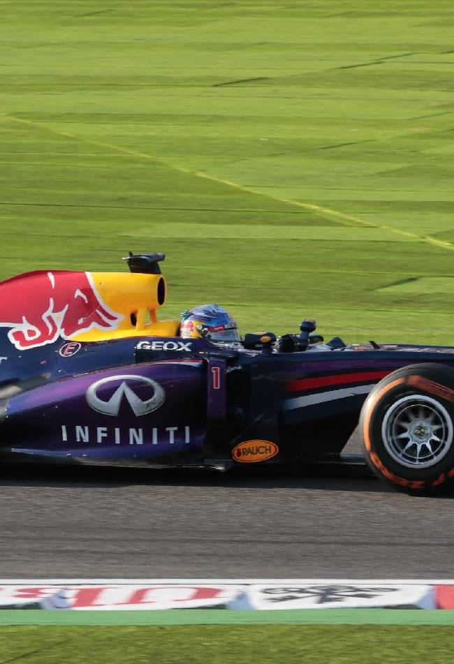 Red Bull driver Sebastian Vettel of Germany steers his car on the way to winning the Japanese Formula One Grand Prix, at the Suzuka circuit in Suzuka, Japan, Sunday, Oct. 13, 2013