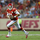Kansas City Chiefs quarterback Alex Smith rolls out during the first half of an NFL preseason football game against the Minnesota Vikings in Kansas City, Mo., Saturday, Aug. 23, 2014 The Associated Press