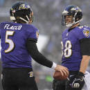 Baltimore Ravens tight end Dennis Pitta, right, celebrates his touchdown with quarterback Joe Flacco in the second half of an NFL football game against the Minnesota Vikings, Sunday, Dec. 8, 2013, in Baltimore. Baltimore won 29-26. (AP Photo/Nick Wass)
