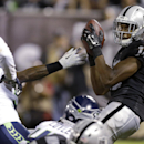 Oakland Raiders wide receiver Brice Butler (12) catches a 15-yard touchdown pass from quarterback Matt McGloin during the second quarter of an NFL preseason football game against the Seattle Seahawks in Oakland, Calif., Thursday, Aug. 28, 2014 The Associa