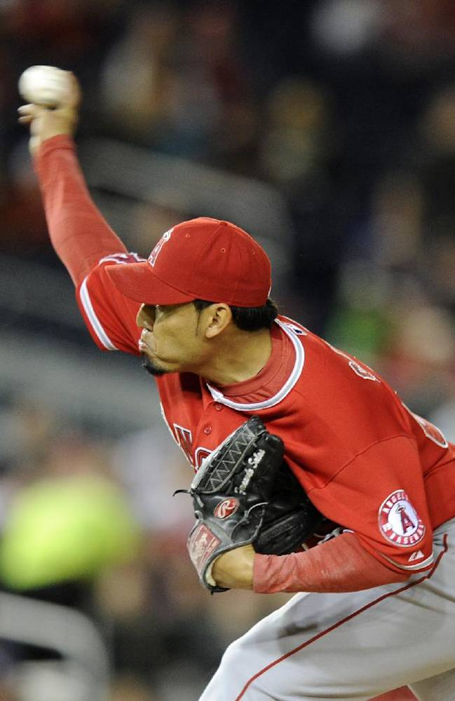 Los Angeles Angels relief pitcher Fernando Salas delivers a pitch against the Washington Nationals during the seventh inning of a baseball game, Monday, April 21, 2014, in Washington. The Angels won 4-2