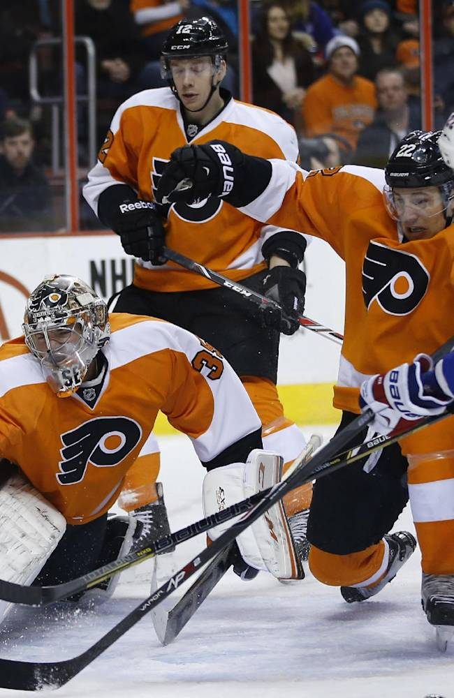 Philadelphia Flyers' Steve Mason (35) reaches for a shot by New York Rangers' Brian Boyle (22) during the first period of an NHL hockey game, Saturday, March 1, 2014, in Philadelphia