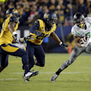 Oregon wide receiver Devon Allen, right, is chased by California linebacker Hamilton Anoa'i, center, and cornerback Cedric Dozier during the first half of an NCAA college football game Friday, Oct. 24, 2014, in Santa Clara, Calif The Associated Press