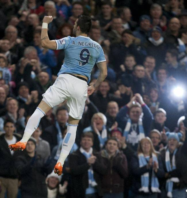 Manchester City's Alvaro Negredo celebrates after scoring against Swansea City during their English Premier League soccer match at the Etihad Stadium, Manchester, England, Sunday Dec. 1, 2013