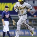 Oakland Athletics' Jonny Gomes rounds the bases after his grand slam off Minnesota Twins pitcher Francisco Liriano in the fourth inning of a baseball game Friday, July 13, 2012, in Minneapolis. (AP Photo/Jim Mone)