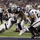 Dallas Cowboys running back DeMarco Murray (29) scores a touchdown in front of Oakland Raiders free safety Charles Woodson (24) during the second half of an NFL football game Thursday, Nov. 28, 2013, in Arlington, Texas The Associated Press