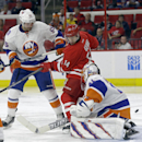 New York Islanders' Johnny Boychuk (55) and goalie Jaroslav Halak, of Slovakia, defend the goal against Carolina Hurricanes' Nathan Gerbe (14) during the second period of an NHL hockey game in Raleigh, N.C., Friday, Oct. 10, 2014 The Associated Press