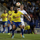 Dynamo Moscow's Aleksandr Kokorin, right, vies for the ball with Estoril's Bruno Miguel during the Europa League group E soccer match between Dynamo Moscow and Estoril at the Antonio Coimbra Da Mota stadium, in Estoril, Portugal, Thursday, Oct. 23, 2014 T