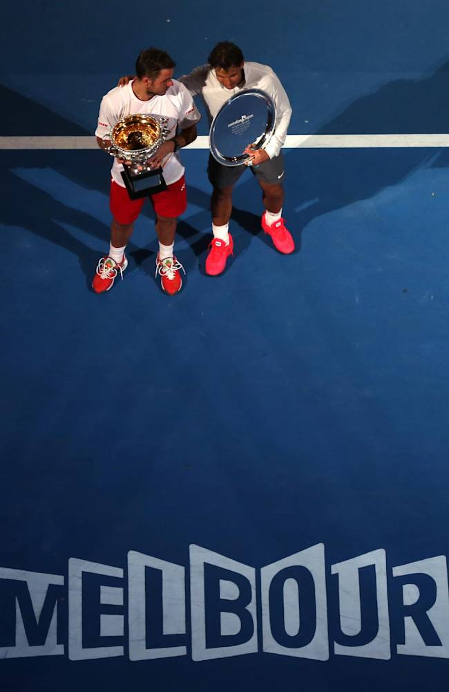 Stanislas Wawrinka of Switzerland, left, talks with runner-up Rafael Nadal of Spain, right, after his win in their  men's singles final at the Australian Open tennis championship in Melbourne, Australia, Sunday, Jan. 26, 2014