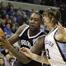 Memphis Grizzlies' Mike Miller, right, pressures Brooklyn Nets' Andray Blatche during the first half of an NBA basketball game in Memphis, Tenn., Saturday, Nov. 30, 2013 The Associated Press