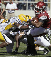 Arkansas running back Jonathan Williams (32) carries before being tackled by Southern Mississippi defensive back Debarriaus Miller (26) during the first quarter of an NCAA college football game in Fayetteville, Ark., Saturday, Sept. 14, 2013. (AP Photo/Danny Johnston)