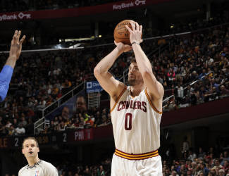 CLEVELAND, OH - MARCH 29: Kevin Love #0 of the Cleveland Cavaliers takes a shot against the Philadelphia 76ers on March 29, 2015 at Quicken Loans Arena in Cleveland, Ohio. (Photo by David Liam Kyle/NBAE via Getty Images)