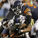 Baltimore Ravens running back Ray Rice (27) is stopped by Chicago Bears safety Major Wright, left, and defensive end Julius Peppers during the second half of an NFL football game, Sunday, Nov. 17, 2013, in Chicago The Associated Press