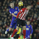 Southampton's Dusan Tadic, right, attempts to head the ball under pressure from Manchester United's Michael Carrick during their English Premier League soccer match between Southampton and Manchester United at St Mary's stadium in Southampton, England, Mo