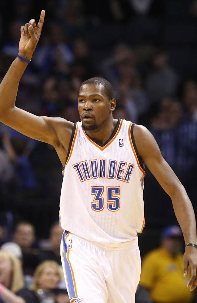 Oklahoma City Thunder forward Kevin Durant (35) gestures after making a basket in the second quarter of an NBA basketball game against the Brooklyn Nets in Oklahoma City, Thursday, Jan. 2, 2014